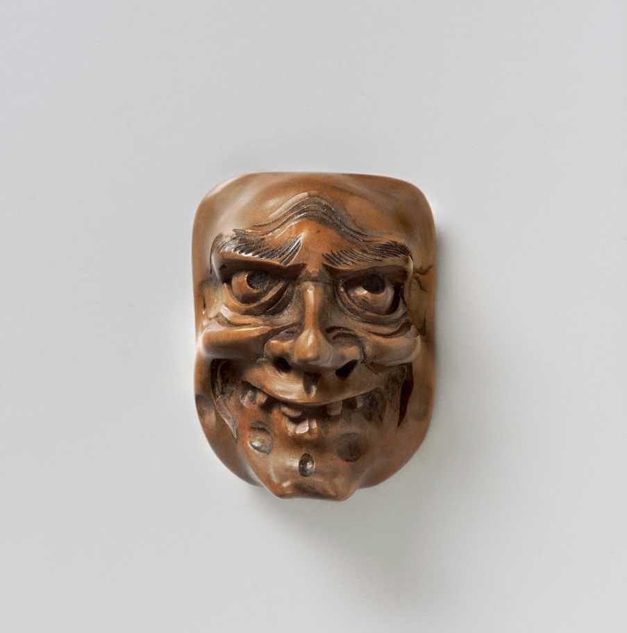 Wood mask netsuke of Shishiguchi