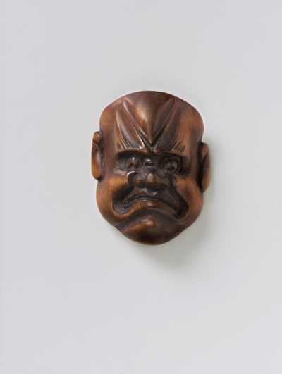 Wood mask netsuke of a Frowning Man,