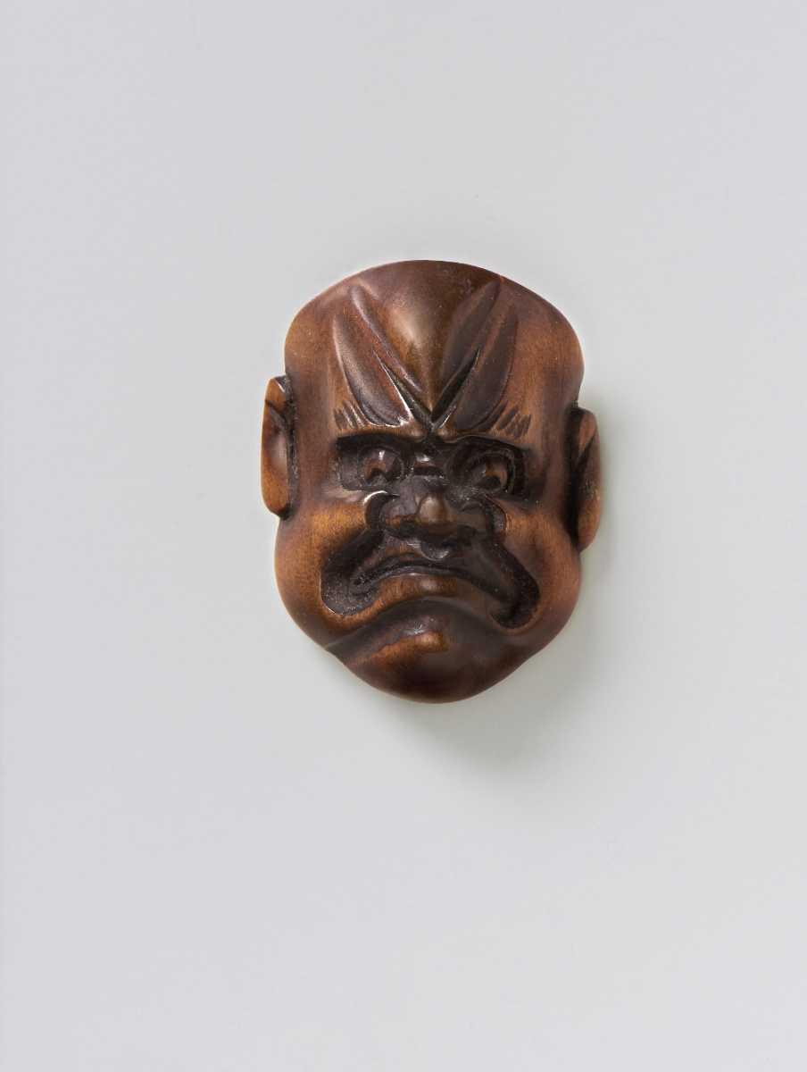 Wood mask netsuke of a Frowning Man,
