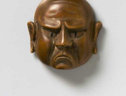Wood mask netsuke of a Grimacing Man