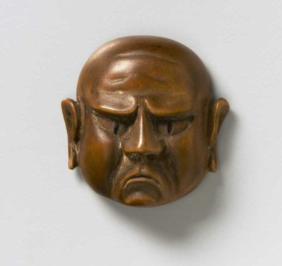 Wood mask netsuke of a Grimacing Man
