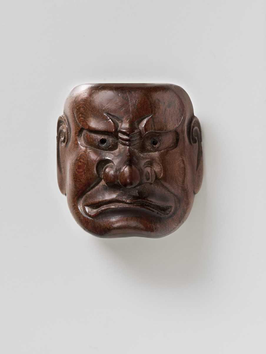 Wood maske netsuke of a Grimacing Man