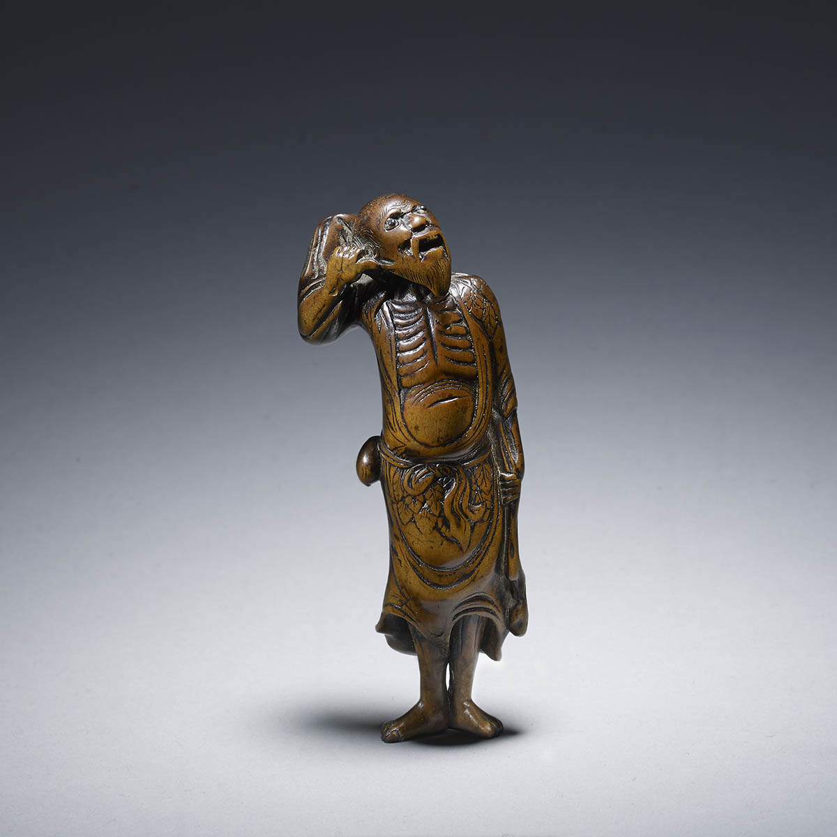 Wood netsuke of Tekkai sennin