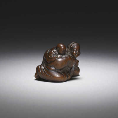 Wood shunga netsuke of a woman and child