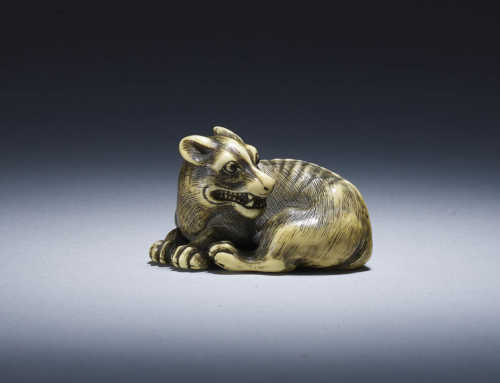 Ivory netsuke of a recumbent wolf