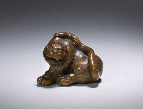 Wood netsuke of a tiger