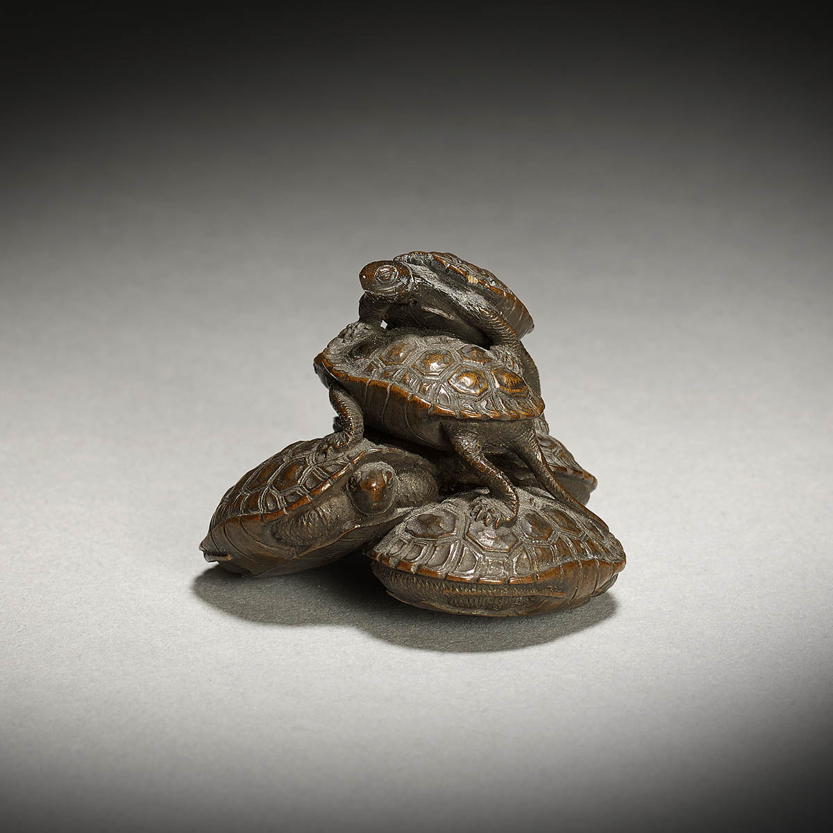 Wood netsuke of five turtles