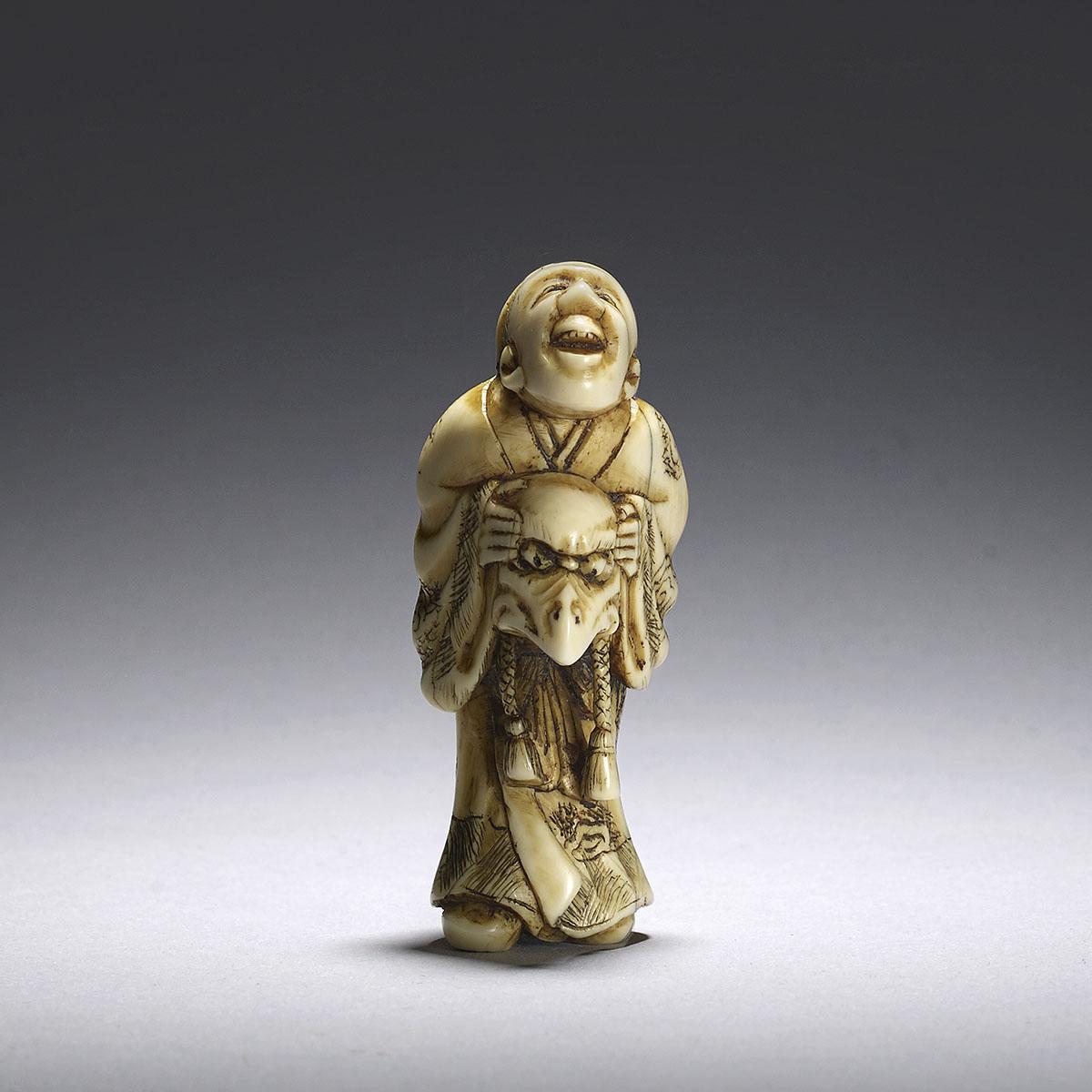 Hidemasa, Ivory netsuke of a man holding a karasu-tengu mask