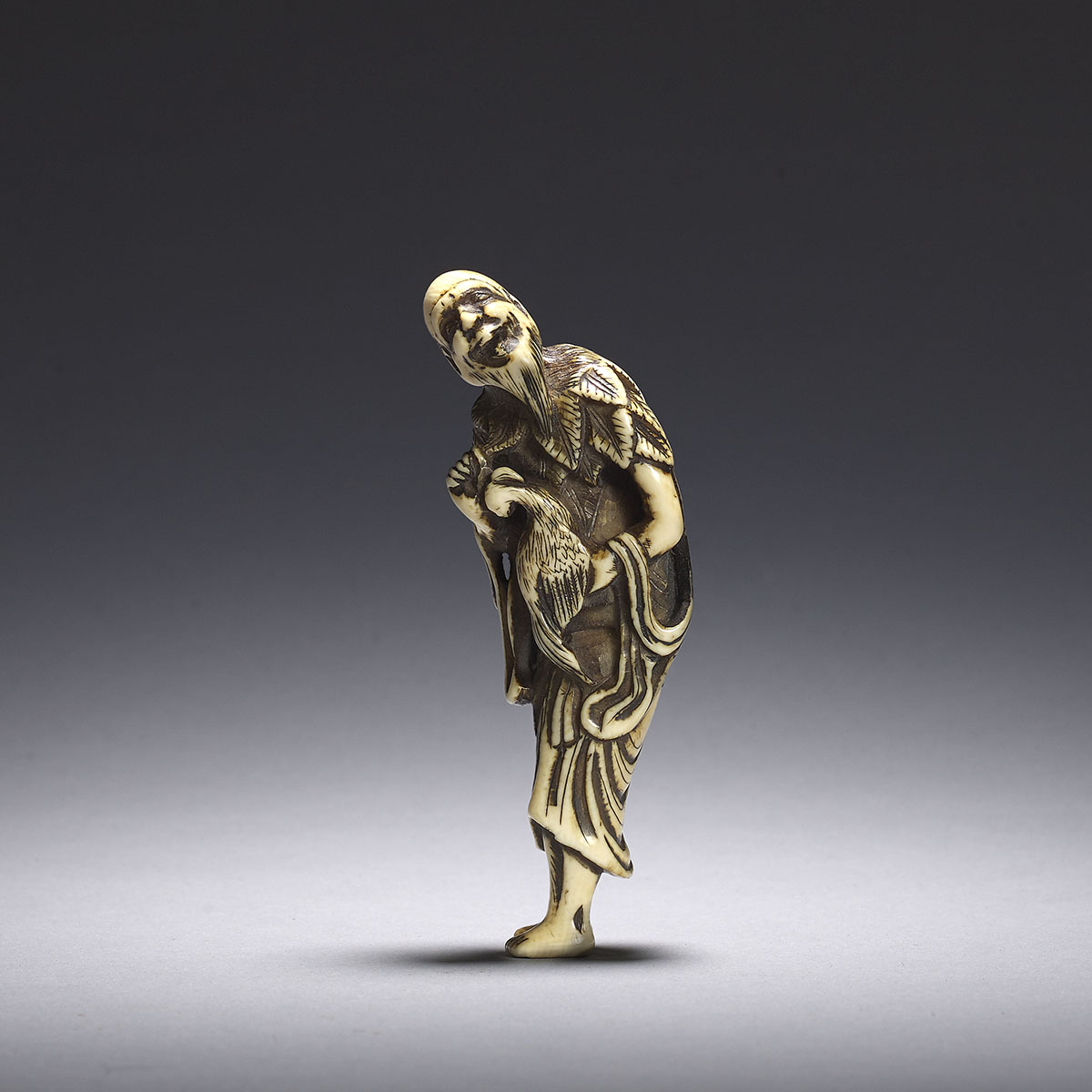vory netsuke of a sennin with a pheasant