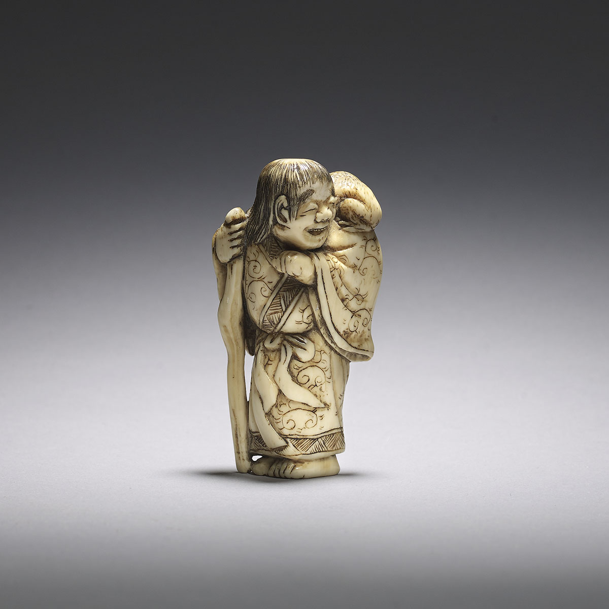 Kyoto school ivory netsuke of a man with minogame
