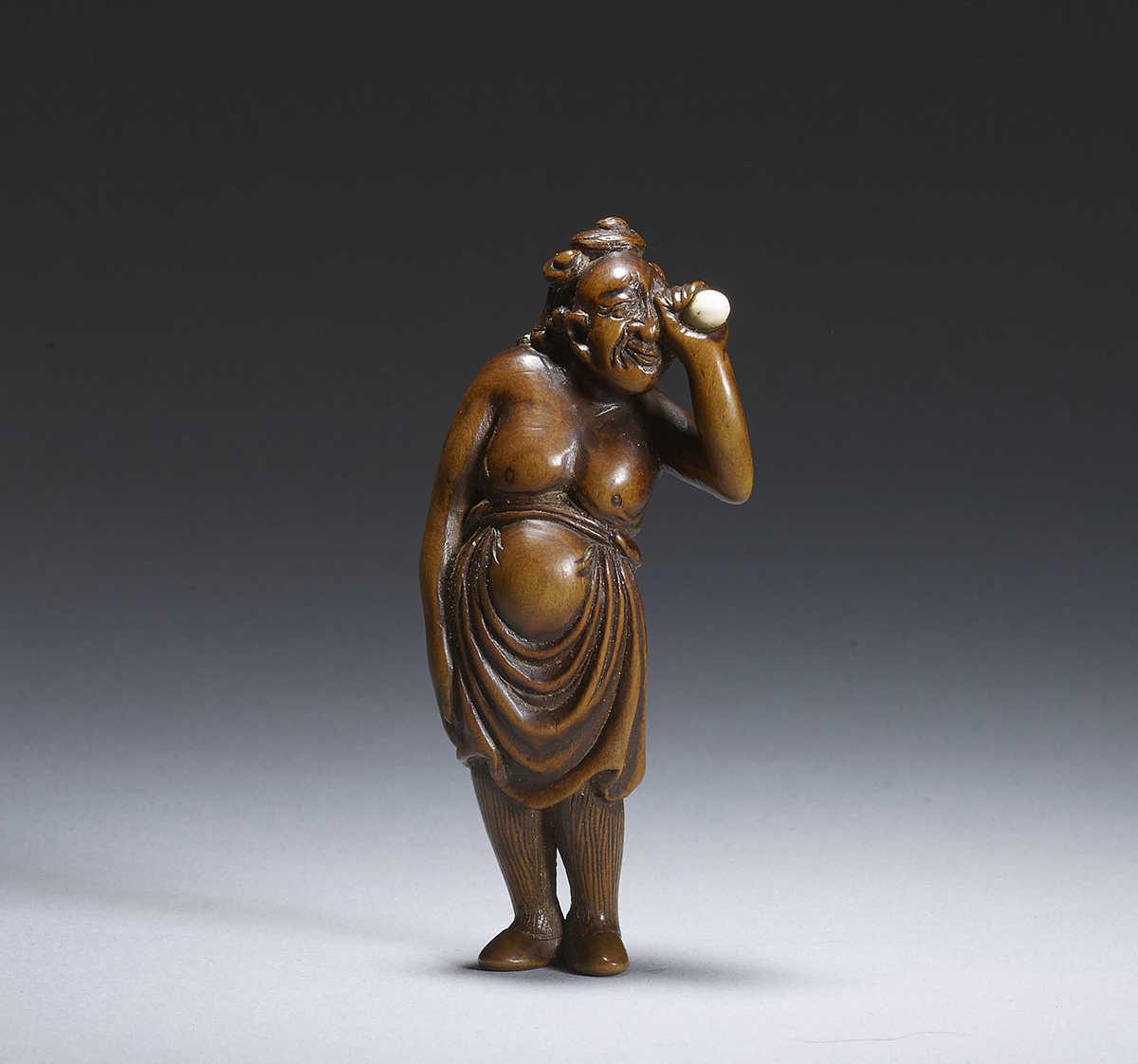 Shugetsu II c. 1800-1840, wood netsuke of an egg tester