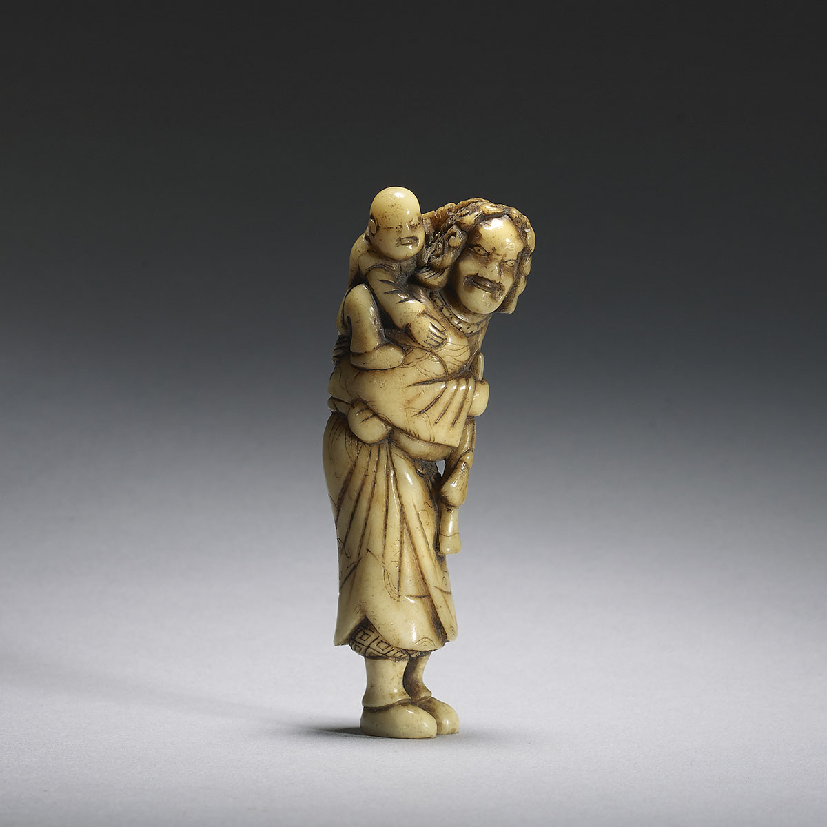 Stag antler netsuke of a Dutchman and boy
