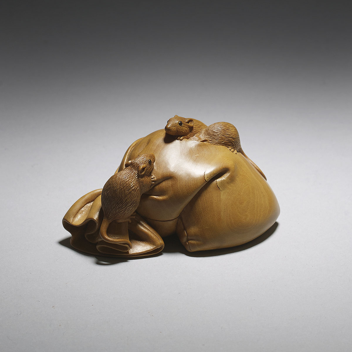 Susan Wraight, boxwood netsuke of three rats on Daikoku's sack