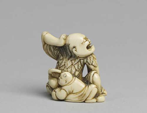 Ivory netsuke of a crouching sennin
