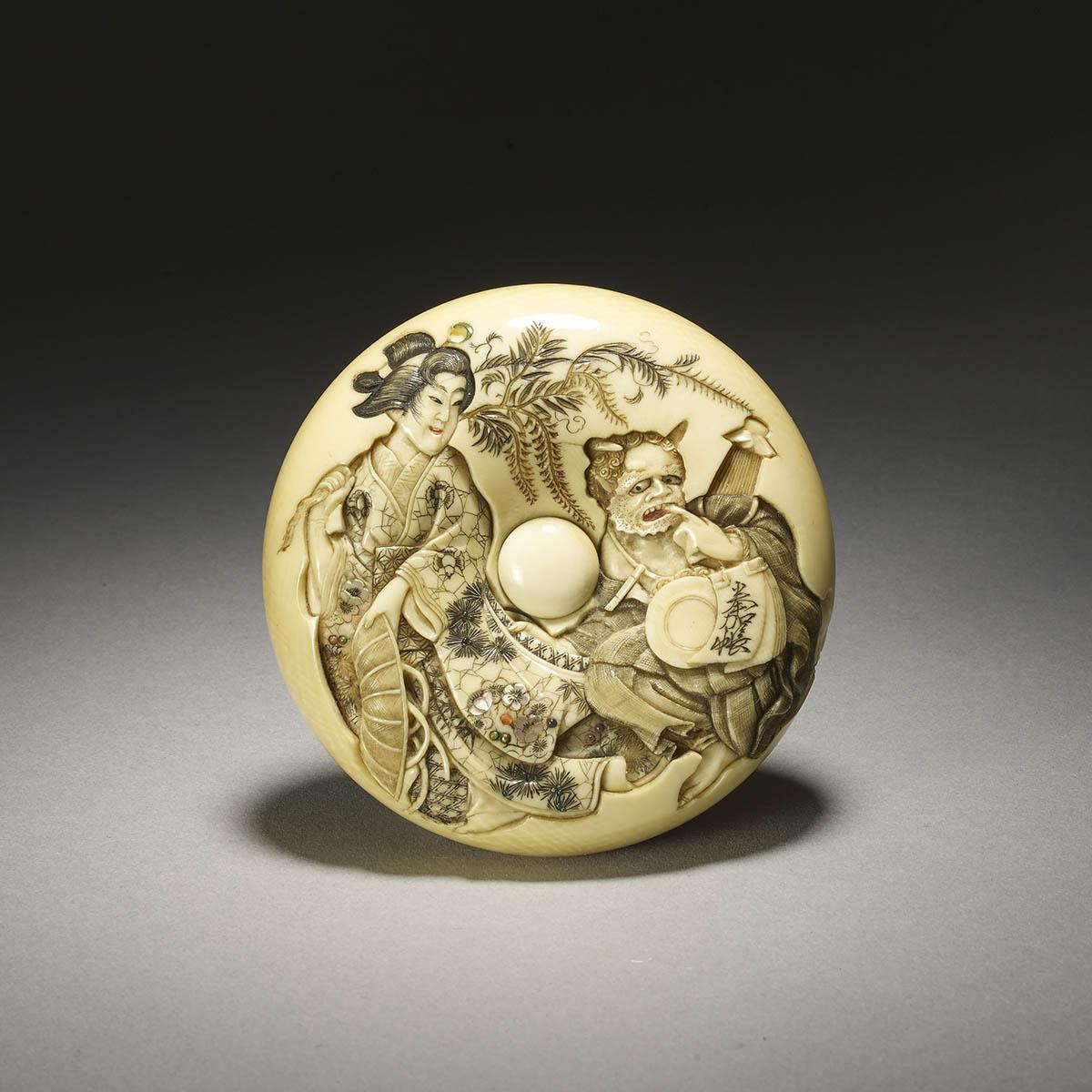 Kikugawa large ivory manju netsuke carved with Fujihime and oni