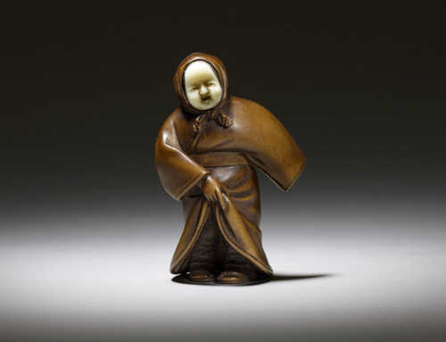 Wood and ivory netsuke of an actor as Okame