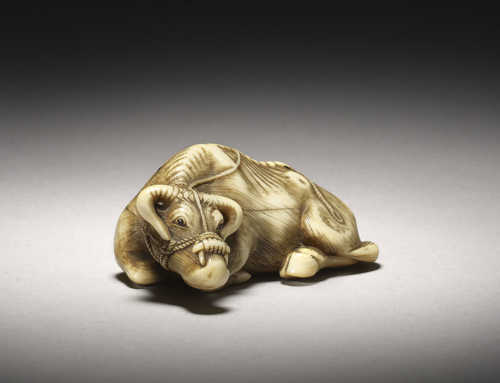 Ivory netsuke of a recumbent ox cow