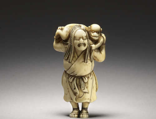 Ivory netsuke of a hunter and monkey