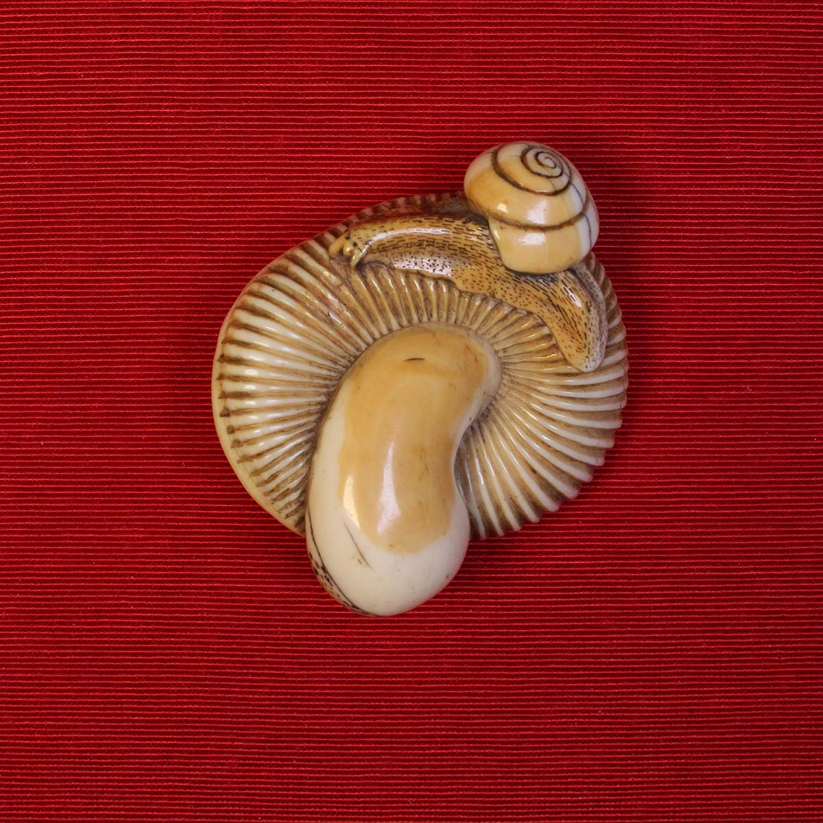 Ivory netsuke of a snail on a mushroom_MR2857