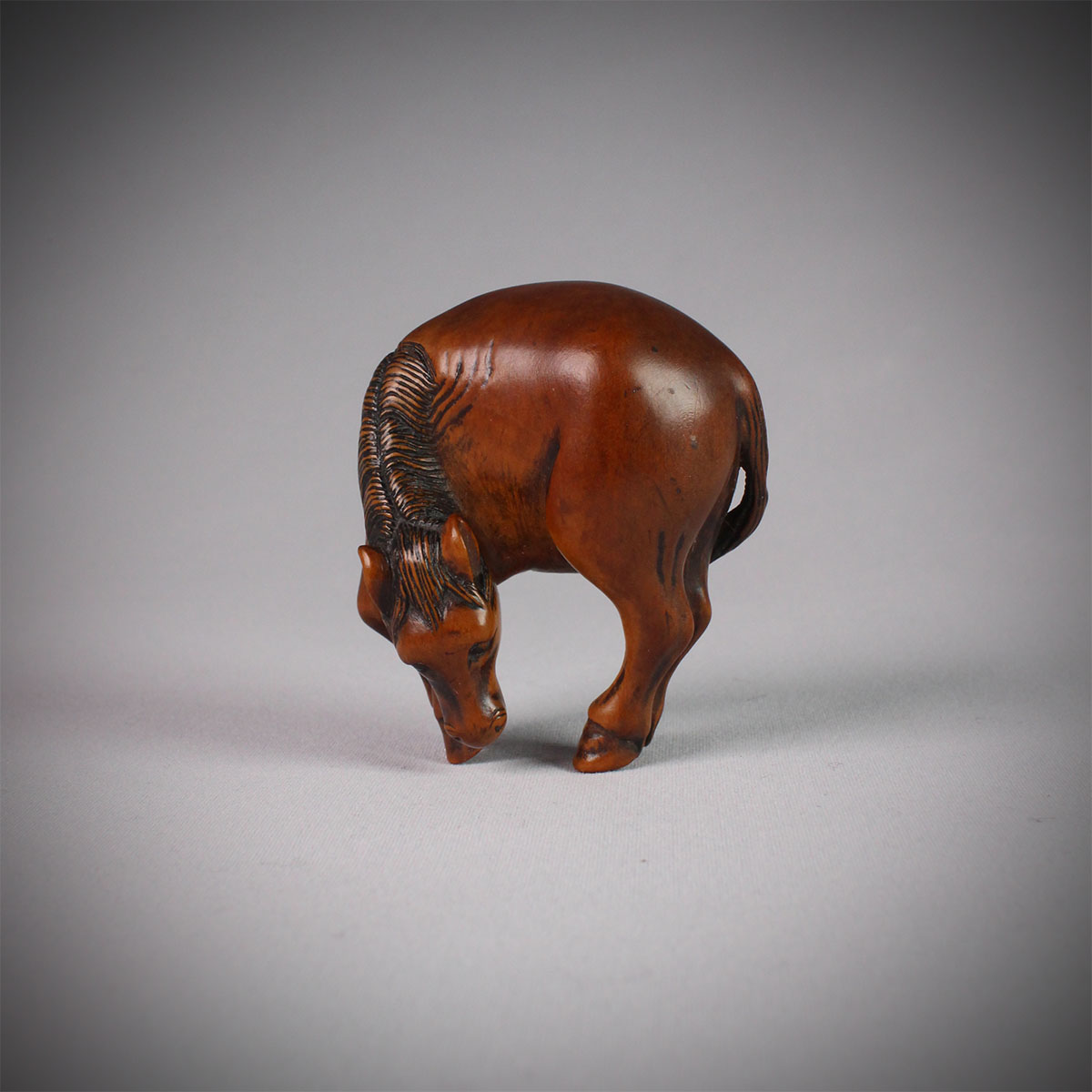 Wood netsuke of a grazing horse, Nobuharu, MR2960_v1