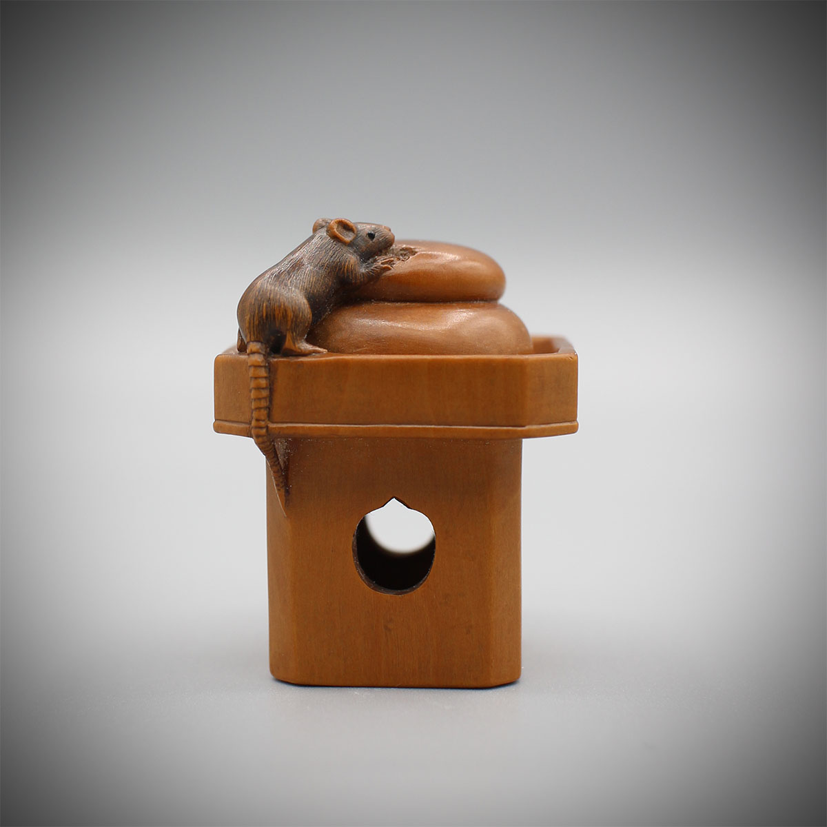 Pale Boxwood netsuke of a rat nibbling at mochi, Masanao of Ise, MR3142_v2