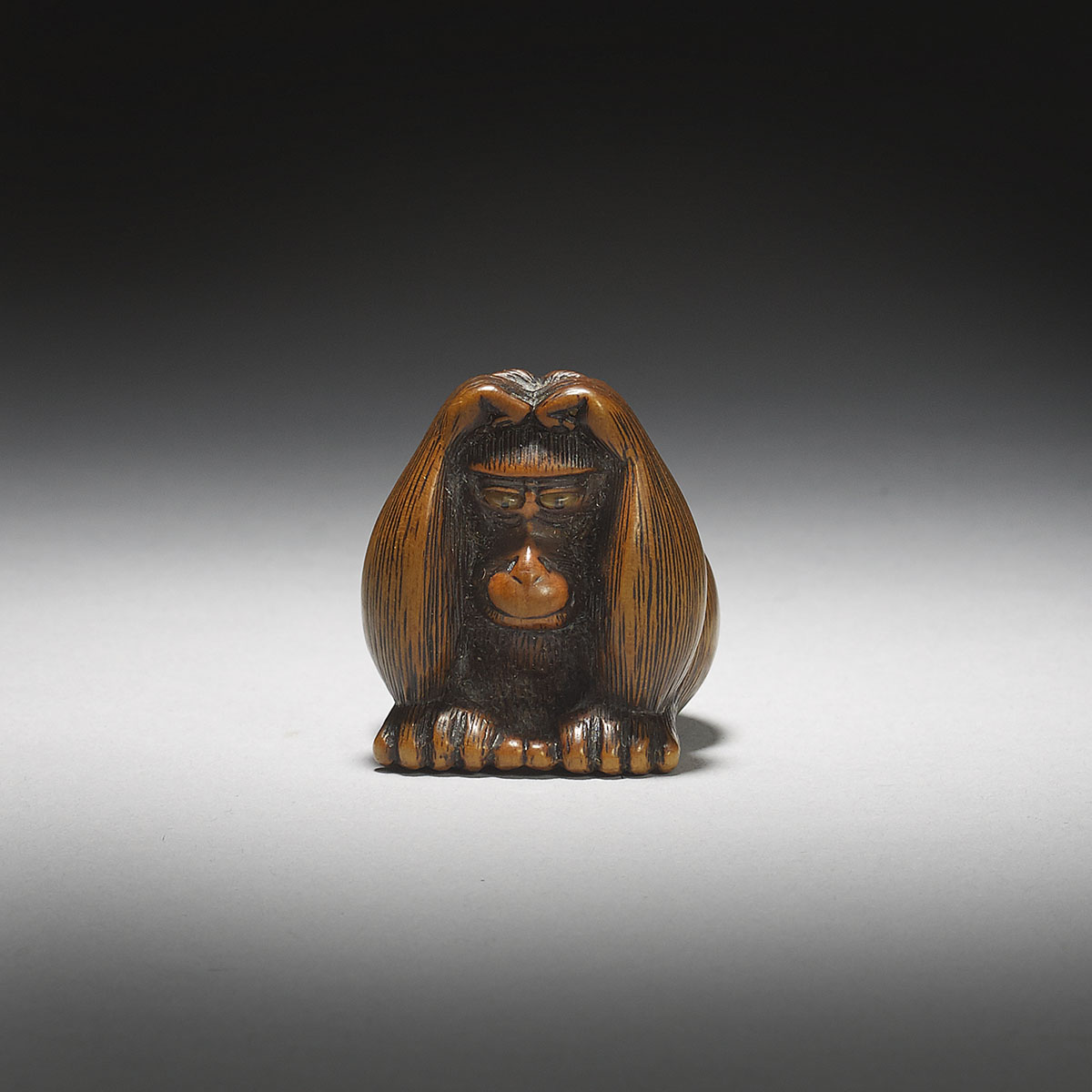 Stained Boxwood Netsuke of a Monkey Holding His Head, MR2963_v1