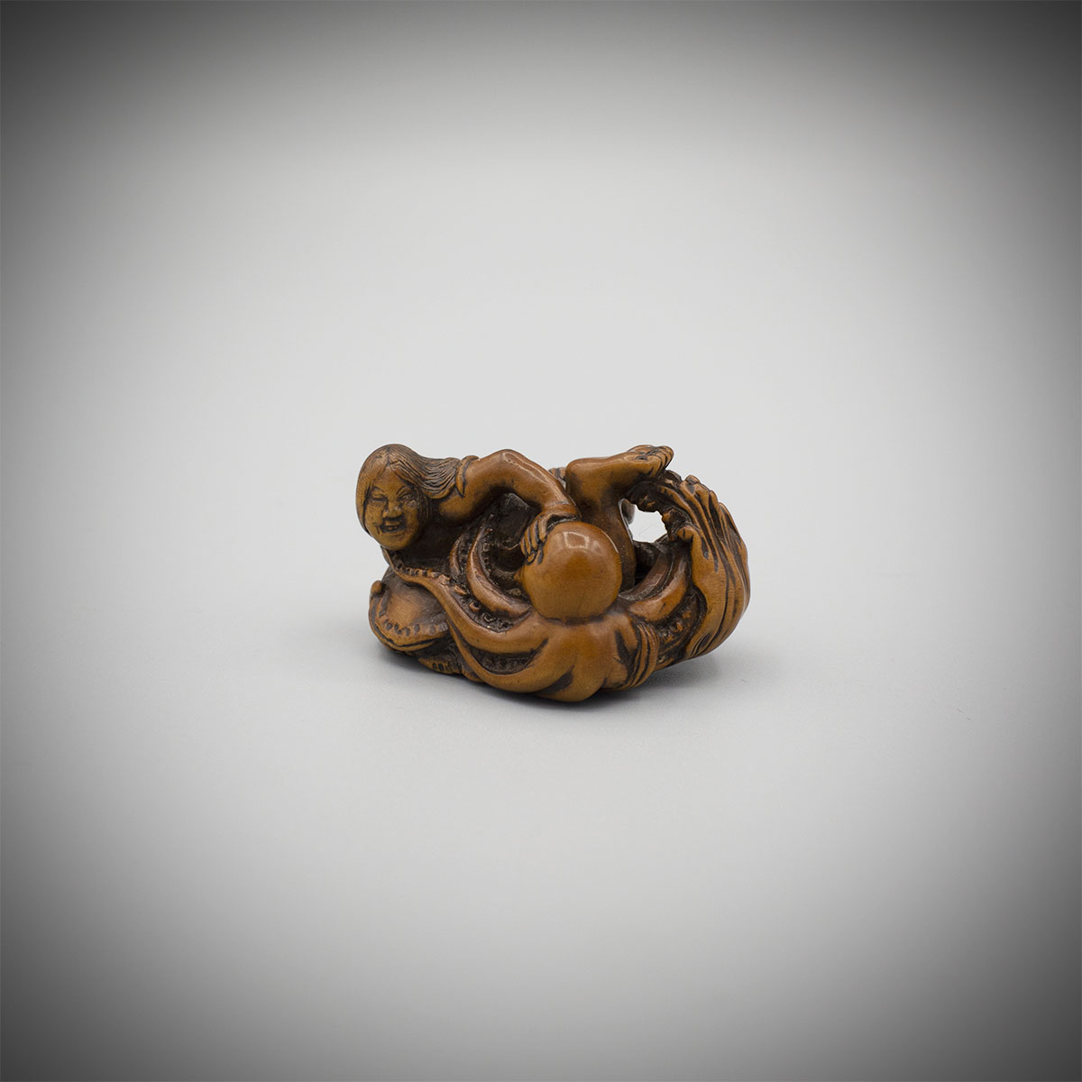 Boxwood netsuke of an ama and octopus by Kokei, MR3233_v1