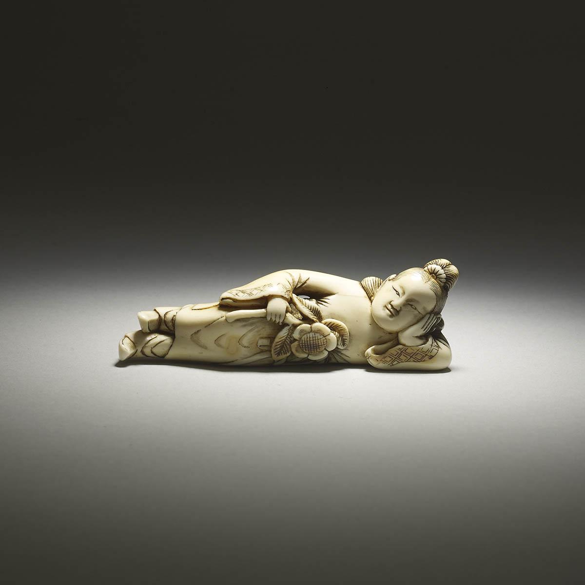 Ivory netsuke of a reclining Chinese woman, MR2493_v1