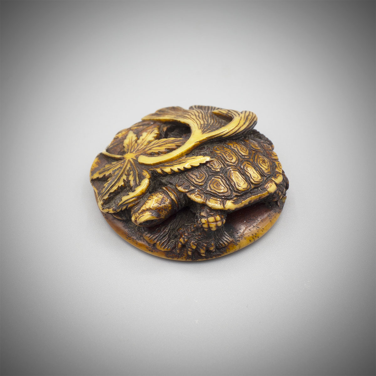 Heavily stained ivory manju netsuke of a turtle, MR3291_v1
