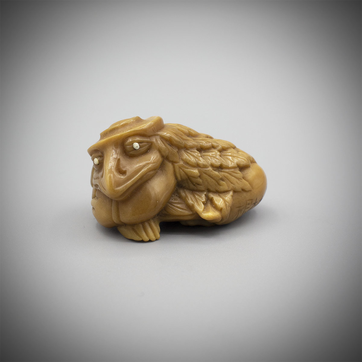 Tagua nut netsuke of sleeping tengu, MR3289_v1