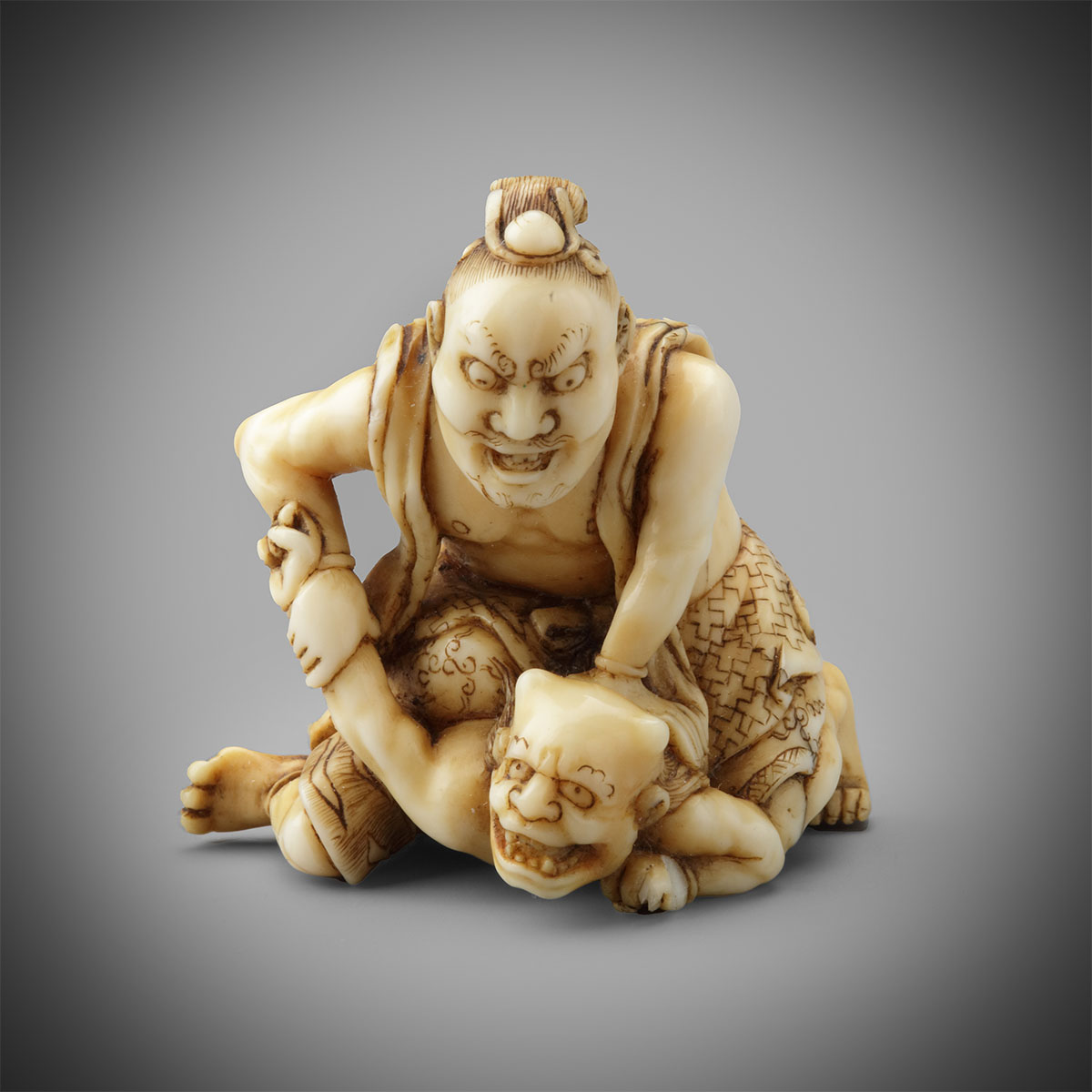 Ivory netsuke of a nio subduing an oni by Hikaku, MR3265_v1