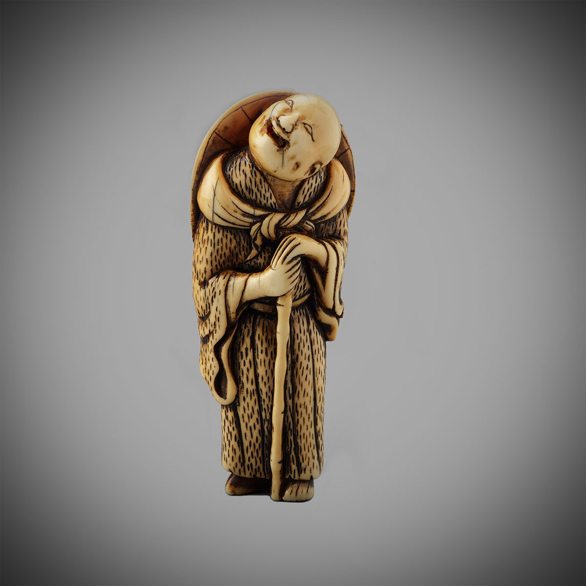 Stained Ivory Netsuke of an Itinerant Priest