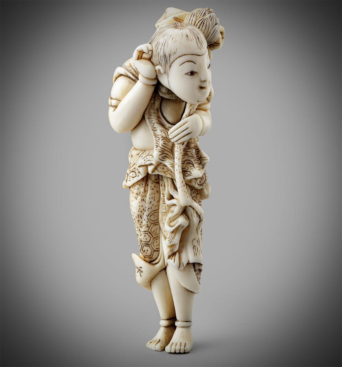 Tall ivory netsuke of a boy holding a lotus stem by Shuyo, MR3276_v1