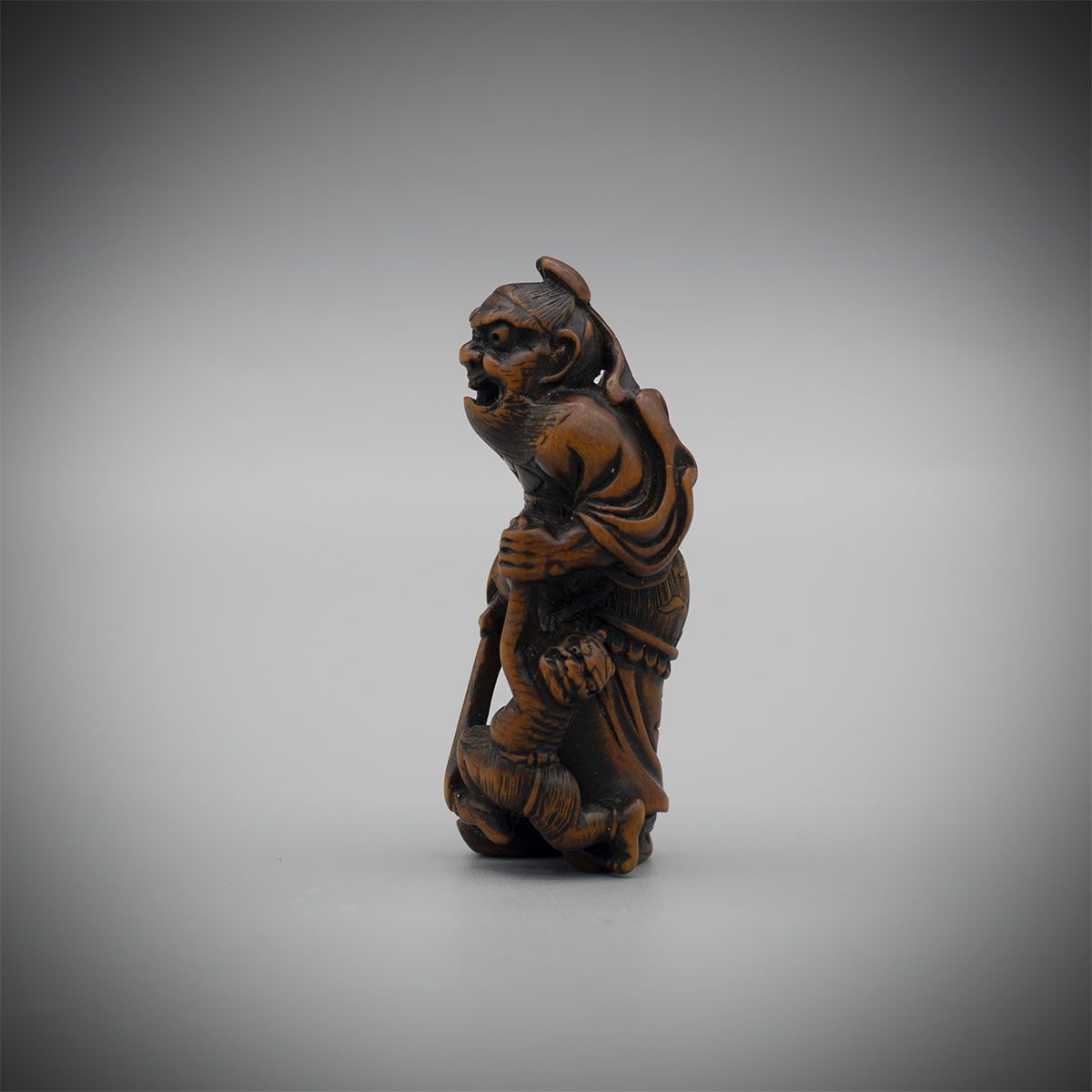 Wood Netsuke of a Shoki Catching Oni, by Issai, MR3282_v1