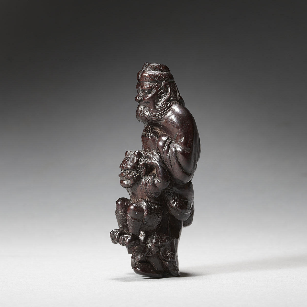 Wood netsuke of Shoki and oni mr14