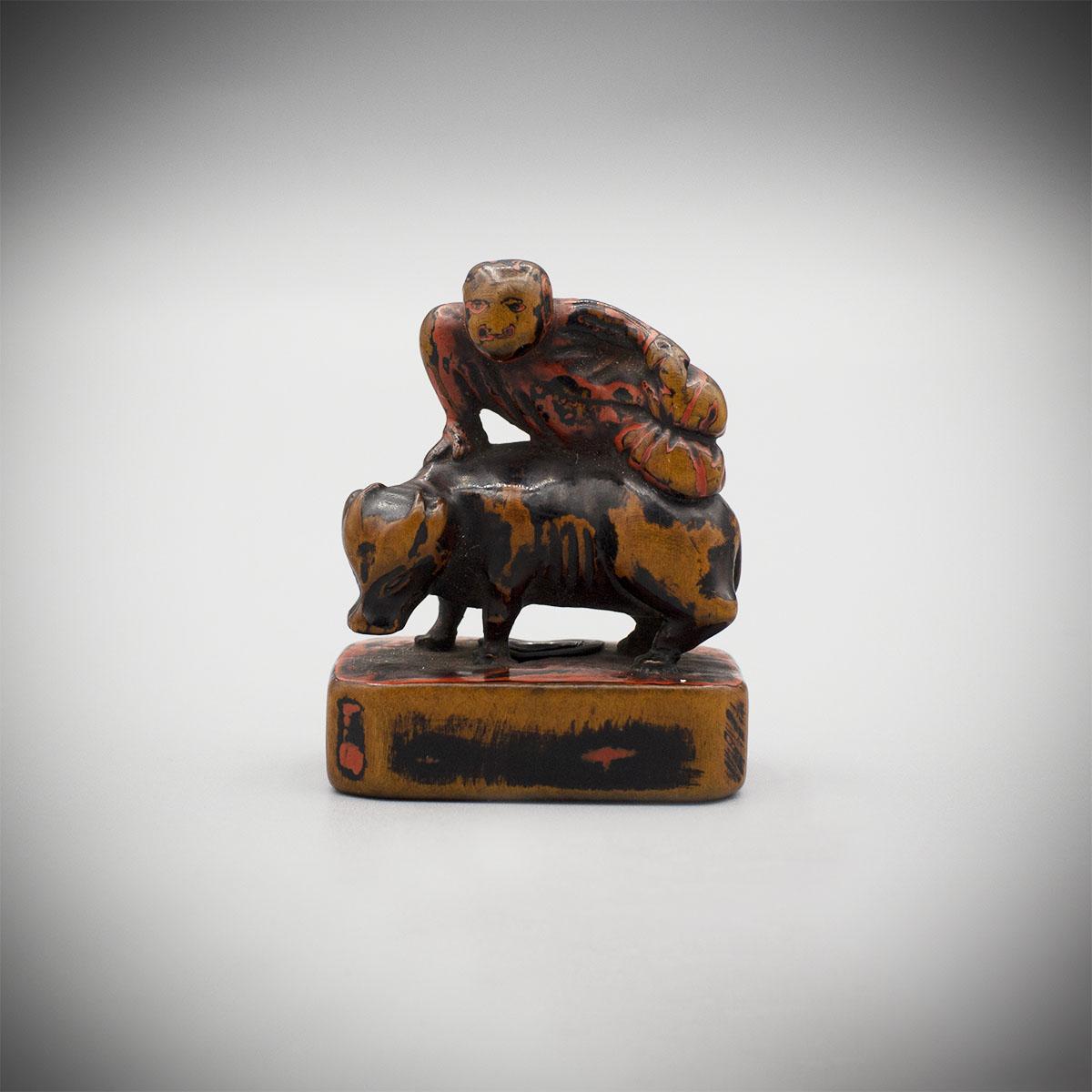 Early Saishiki Netsuke of a Monkey on an Ox MR830_v.1