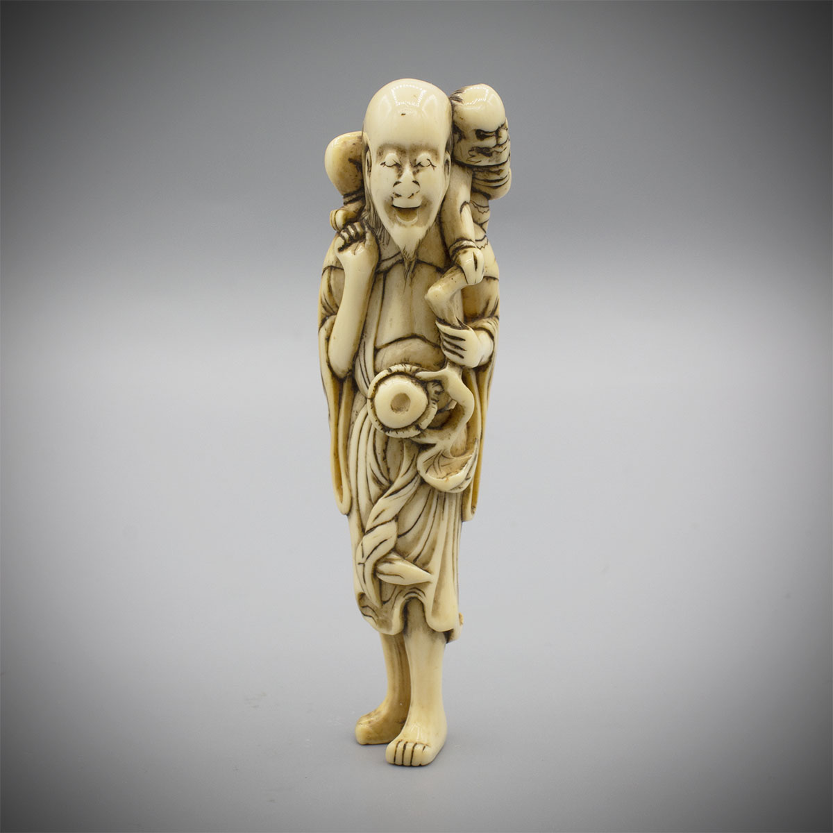 Unusual Ivory Netsuke of a Hermit with Oni MR3395_v.1