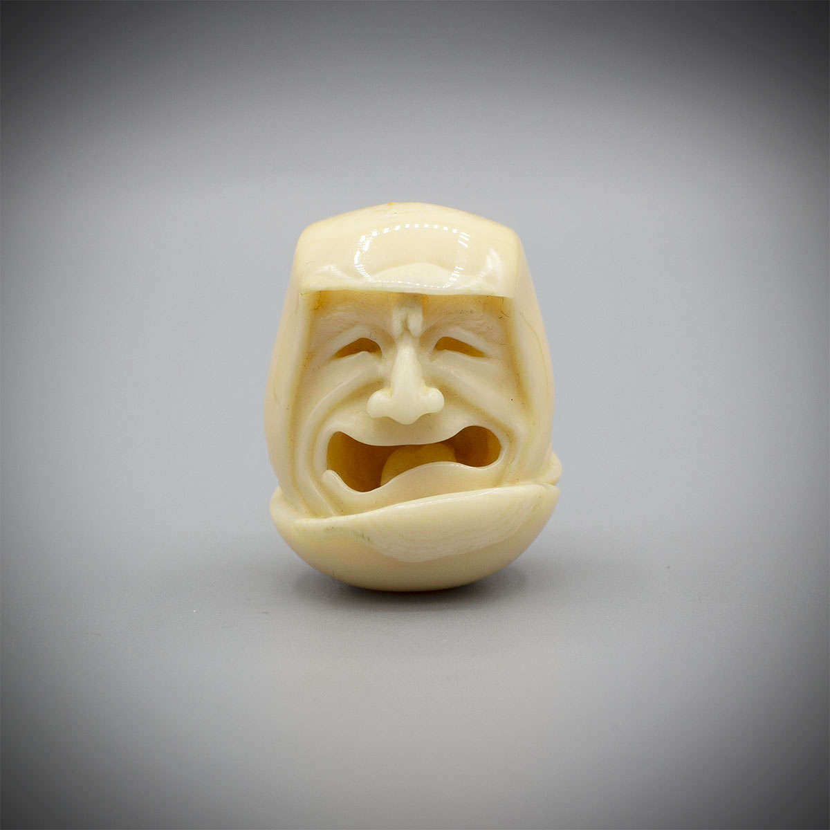 A Walrus Ivory Netsuke of Daruma by Michael Birch MR3529_v.1