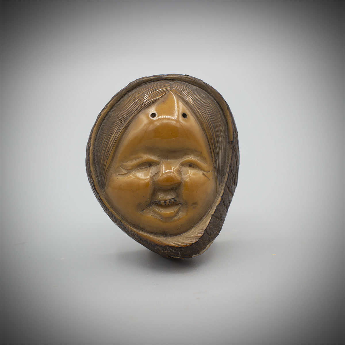 Tagua (corozo) Nut Mask Netsuke of Okame by Gyokuzan MR3526_v.1