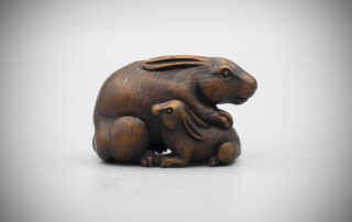 A large dark stained wood netsuke of a hare or rabbit and young, MR3560_v.1