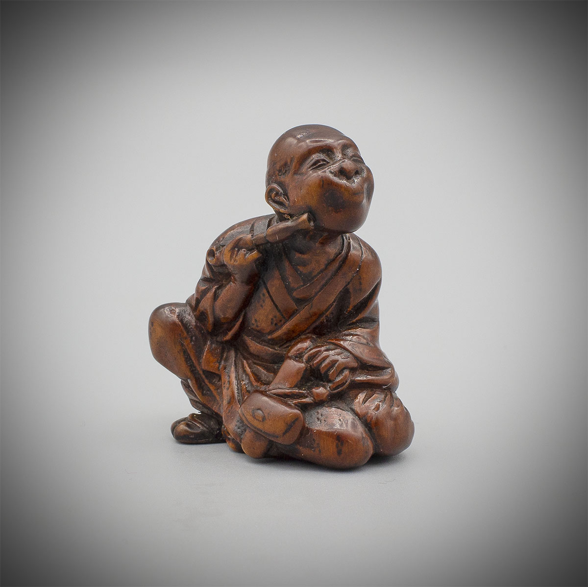 Wood Netsuke of a Smoker, MR3544_v.1