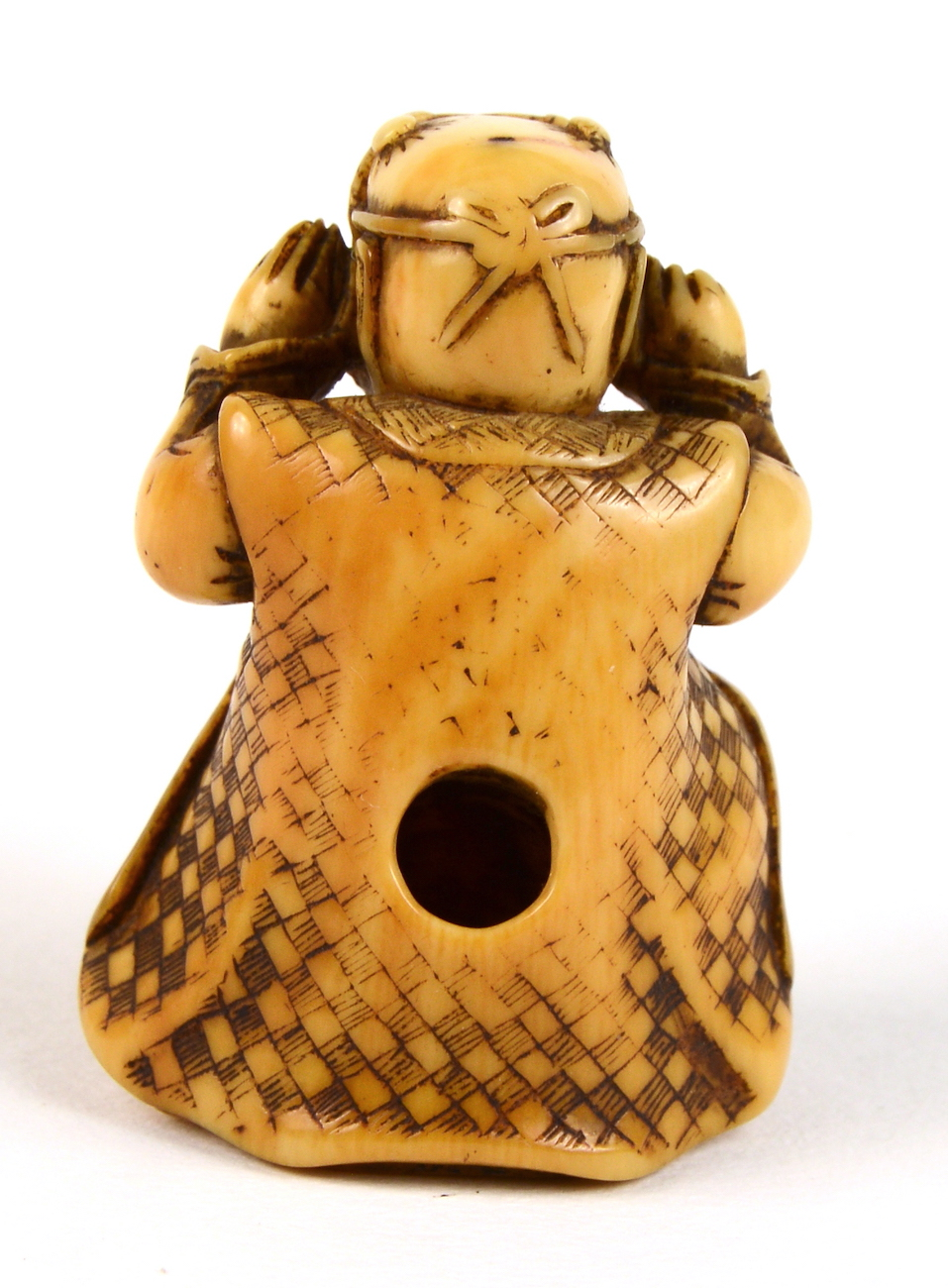 Ivory netsuke of boy with oni mask back