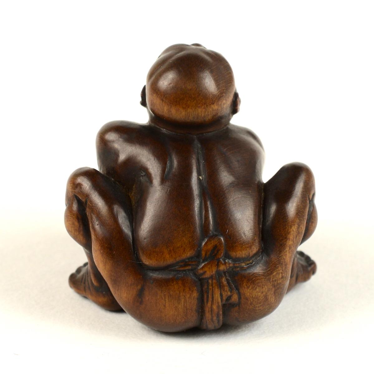 Taku wood stone lifter netsuke back