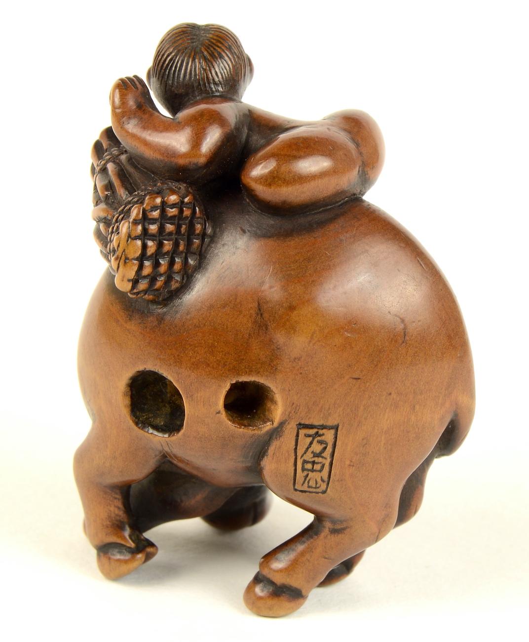 Wood ox and herdboy netsuke reverse