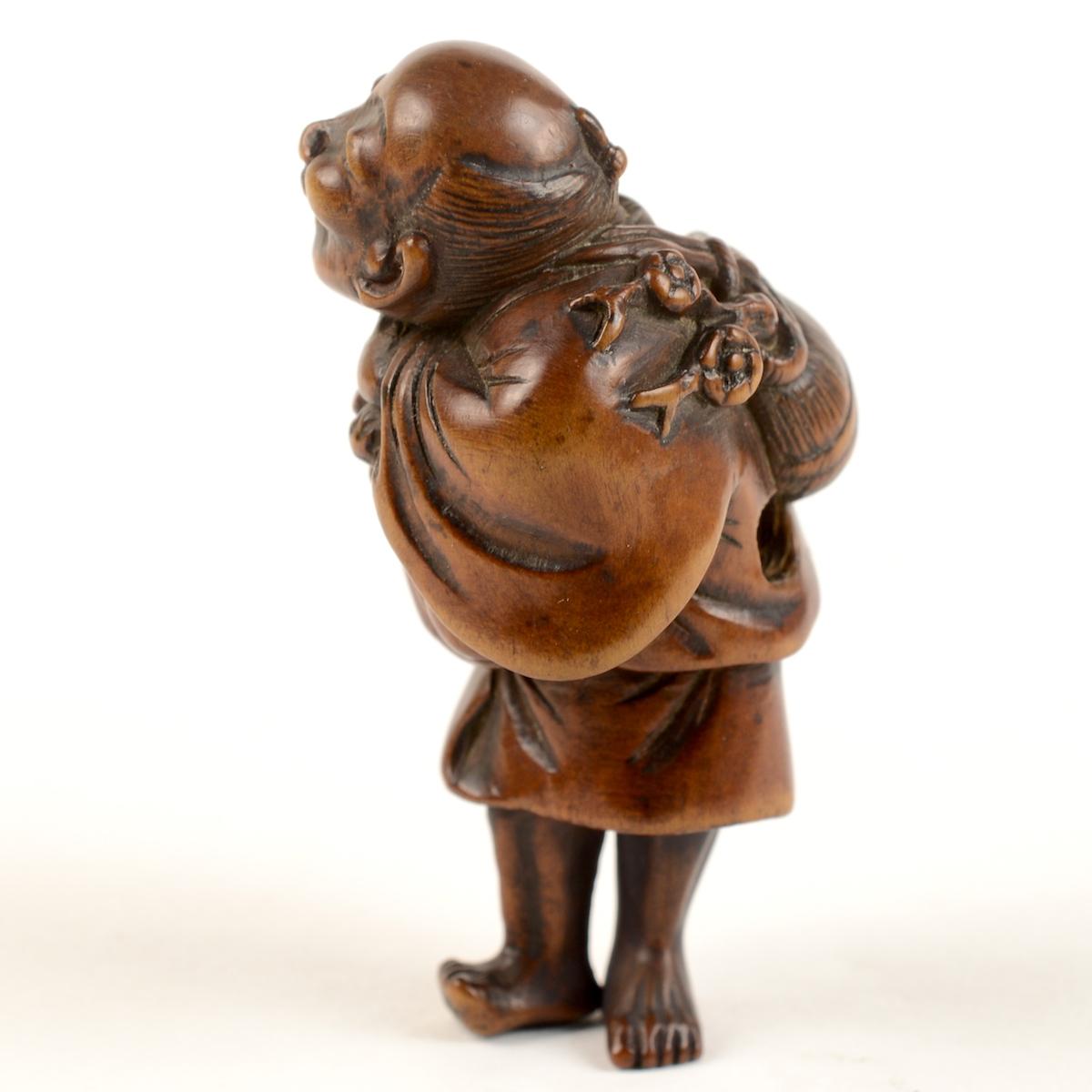 Wood hoshigaki seller netsuke left profile