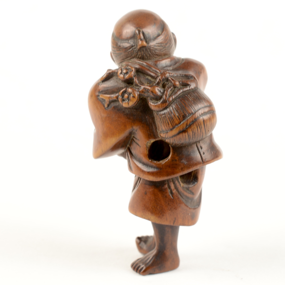 Wood hoshigaki seller netsuke back