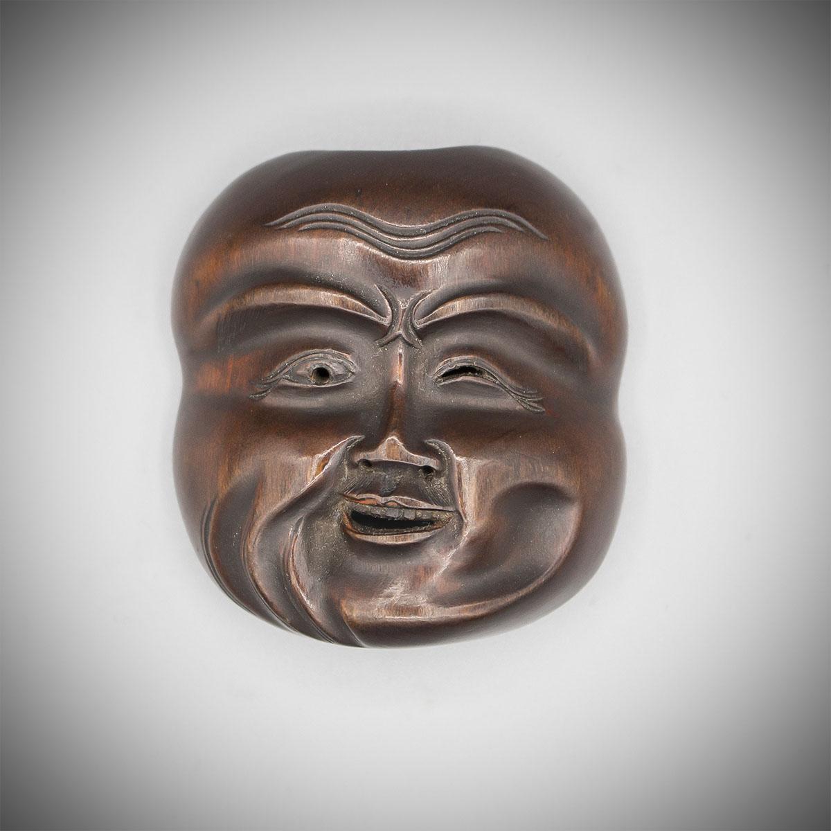 Boxwood mask netsuke by Ghokuzan, MR2722_v.1
