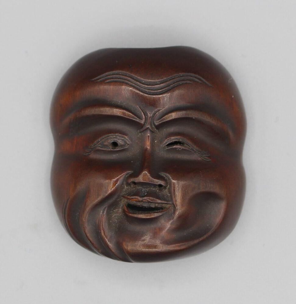 IMG_8617 Gyokuzan winking wood mask netsuke