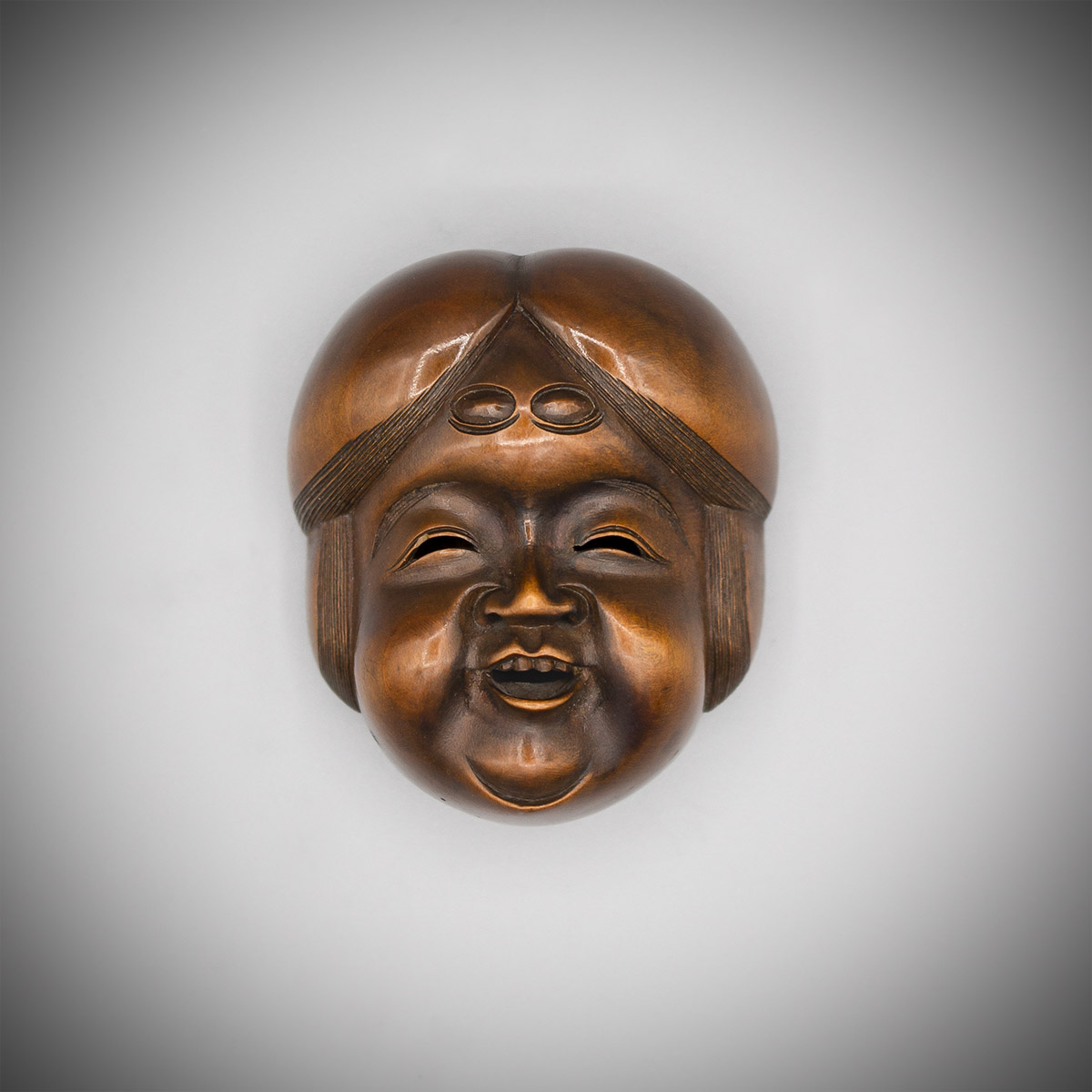 Wood mask netsuke of Okame by Hara Shumin, MR3493_v.1