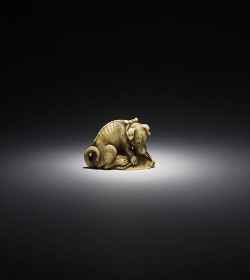 Ivory netsuke of a dog with awabi shell